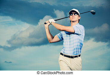 Golfer swinging golf club - Golfer at sunset, Man swinging...