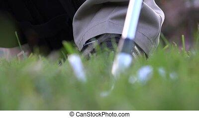 Golfer Swinging Golf Clubs