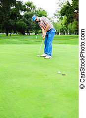 Golfer takes the putting green shot and ball is closing in...