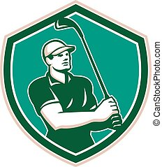 Illustration of a golfer playing golf swinging club tee off set inside shield crest on isolated background done in retro style.