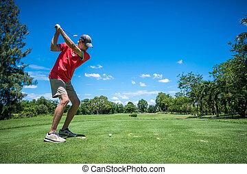 golfer tee off with golf club