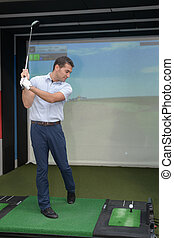 golfer training with a video game