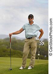Golfer waiting on tee