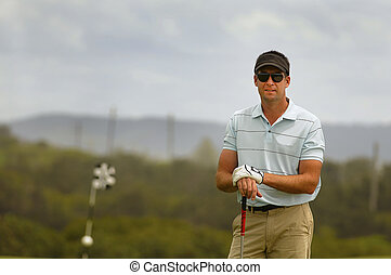 Golfer waiting on the tee