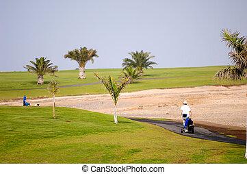 Golfer walking