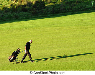 golfer - with caddy on golf course