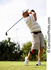 Golfer with knee brace. - Male golfer teeing off with a...