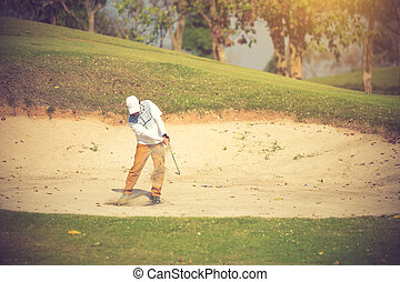Golfers hit the ball in the sand. Speed and Strength. Vintage Color