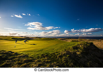 Golfers on a lovely golf course in St. Andrews