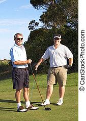 Golfers on the tee box