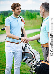 Golfers shake hands with each other