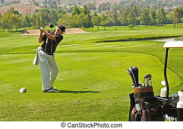 Golfing at a Resort - A golf course and senior golfers in...