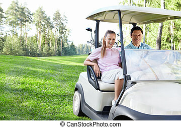 Golfing - Young couple in the car for golf