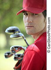 golfspeler, golf, clubs., vasthouden
