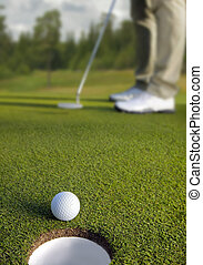 golfspieler, setzen, vorgewählter fokus, auf, golf- kugel