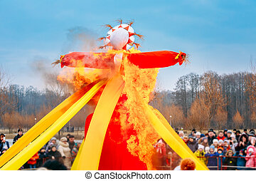 Burning Effigies Straw Maslenitsa In Fire On The Traditional National Holiday Dedicated To The Approach Of Spring - Slavic Celebration Shrovetide.