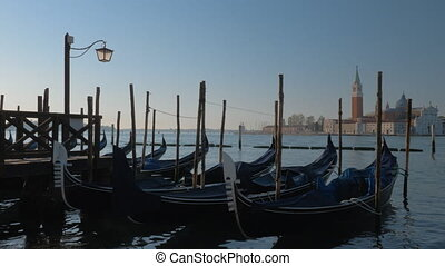 Gondola boats with a church in the background