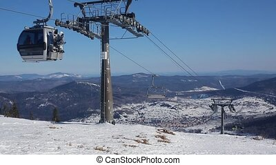 Gondola cable car ski lift against blue sky