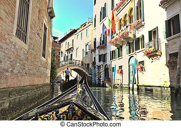 Gondola in a canal of Venice, Italy