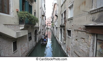 Gondola in Venice - Scenic canal with gondola, Venice, Italy...