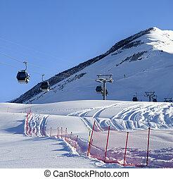 Gondola lift on ski resort at sun winter day