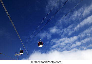 Gondola lifts at ski resort and blue sky with clouds in nice day