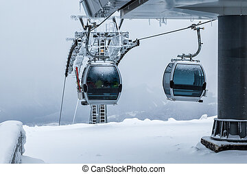 Gondola lifts on top of the mountain in winter