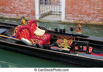 Gondola moored in narrow canal in Venice, Italy