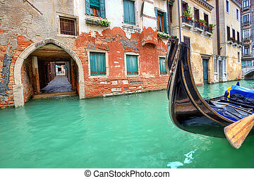 Gondola on small canal in Venice, Italy.