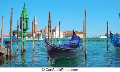 Gondola on the berth and San Giorgio di Maggiore church in...