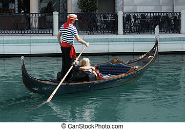 Gondola Ride - Couple having a romantic ride down a canal in...