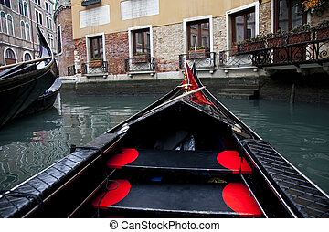 Gondola sailing in Venice channel