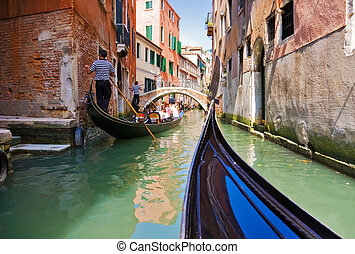 Gondola trip on small Venice canals.