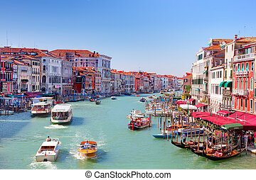 Gondolas and tourist boats traffic on the Grand Canal in...