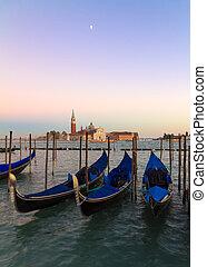 Gondolas at sunset with San Giorgio di Maggiore church, Venice, Venezia, Italy
