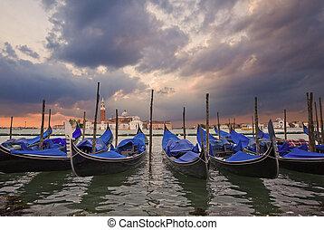 Gondolas bobbing in lagoon outside San Marco Piazza Venice...