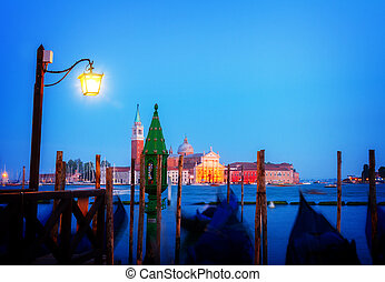 Gondolas floating in the Grand Canal at night, Venice