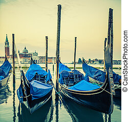 Gondolas floating in the Grand Canal at sunset