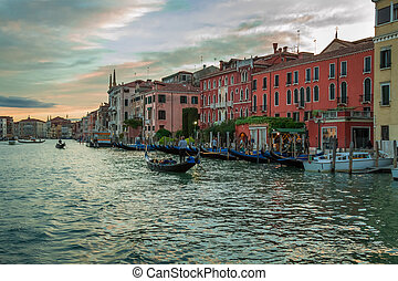 Gondolas floating on the Grand Canal at sunset in Venice