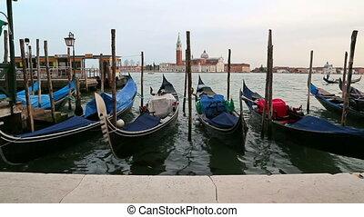 Gondolas in Venezia, Italy. - Gondolas moored, San Marco,...