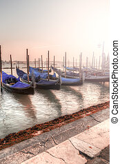 Gondolas in Venice at Sunset. Romantic View