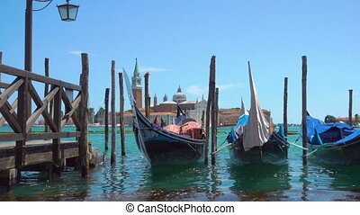 Gondolas in Venice - Gondolas on the berth and San Giorgio...