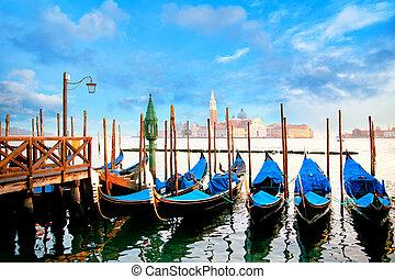 Gondolas in Venice - Moored gondolas in a rowon bright sunny...