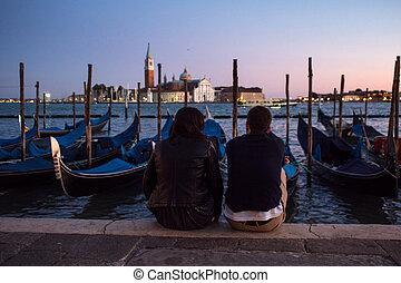 Gondolas moored by Saint Mark square with San Giorgio di Maggiore church on background