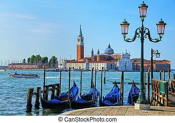 Gondolas moored near San Marco square across from San Giorgio Maggiore island in Venice, Italy