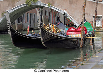 gondolas moored on canal
