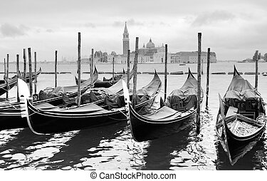 Gondolas near Saint Mark square in Venice, Italy. Black and...