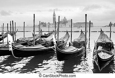 Gondolas near Saint Mark square in Venice, Italy. Black and...