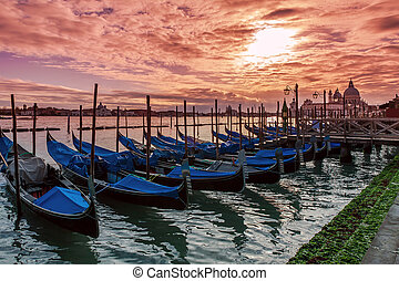 Gondolas on Grand canal at sunset in Venice.