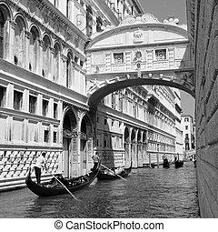 Gondolas passing over Bridge of Sighs - Ponte dei Sospiri. Venice, Veneto, Italy, Europe.